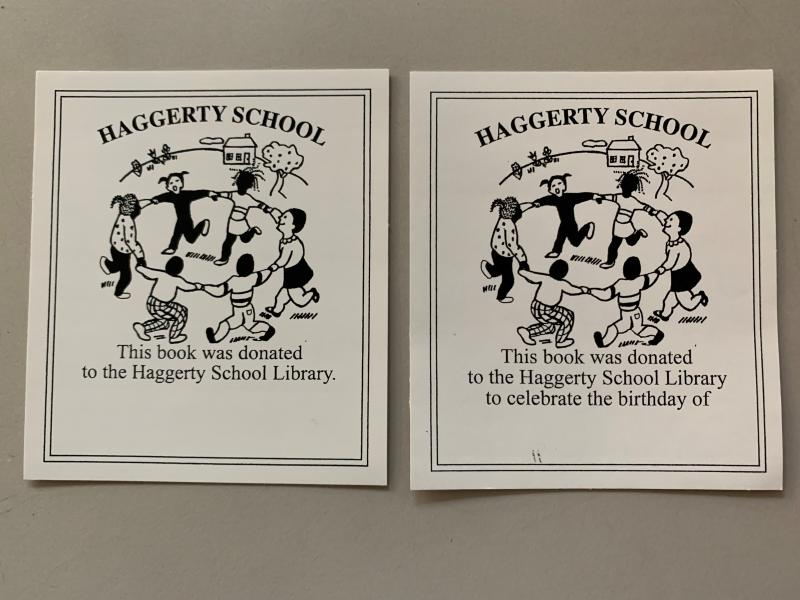 "Haggerty School bookplates showing kids in a circle in front of a schoolhouse, with text on the left that reads ""This book was donated to the Haggerty School Library."" Text under the right bookplate reads ""This book was donated to the Haggerty School Library to celebrate the birthday of"" with room to write a name."
